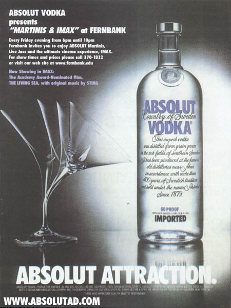 Glass bending towards bottle.  Special ad for IMAX theater.