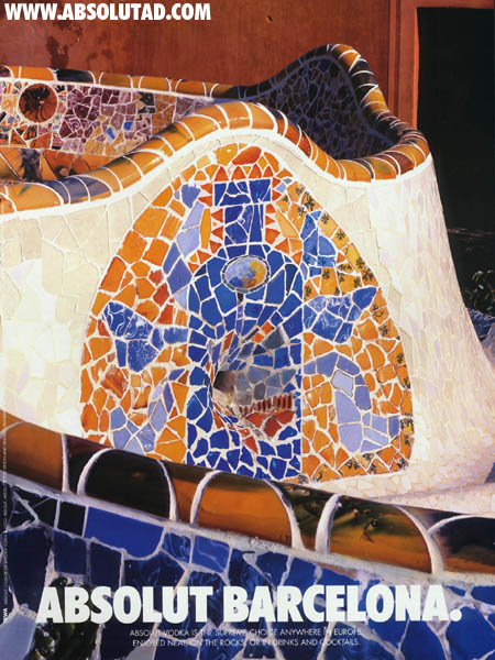 Mosaic tiles on a fountain in the shape of a bottle.