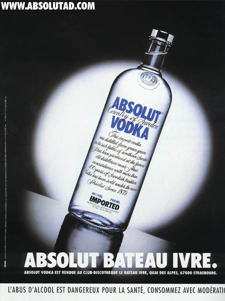 Standard bottle with white spotlight.  The whole ad is tilted to the right so that the bottle is sliding down the counter.