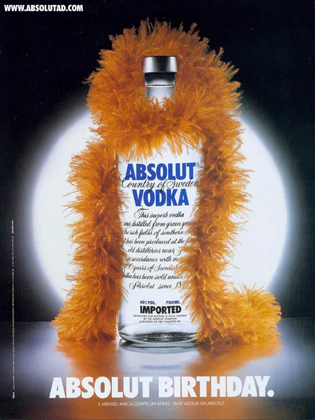 Happy Birthday Absolut! Bottle with an orange boa around it's neck.