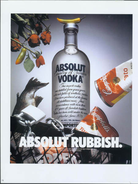 Trash can with Absolut bottle and pepper ad in it.