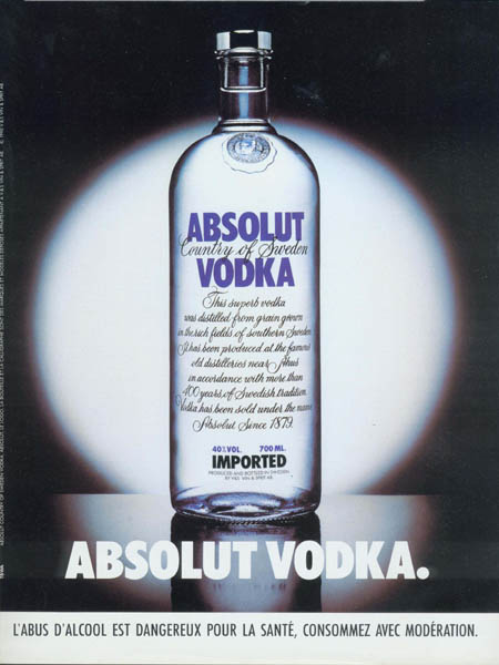 Standard Absolut bottle under spotlight.
