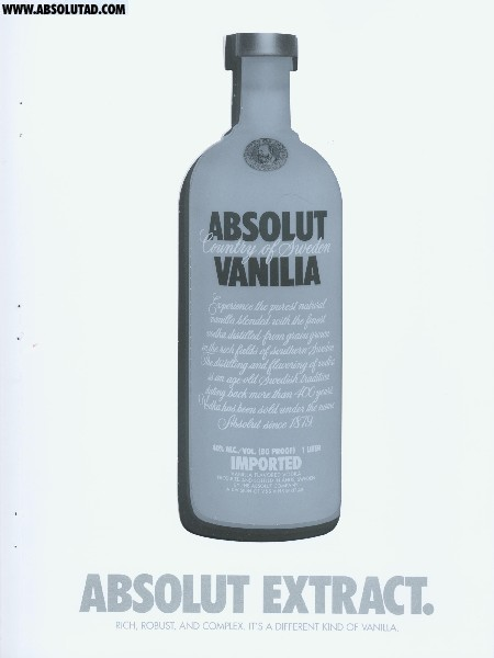 white cardboard (or thick paper) ad with a large die cut Absolut bottle. The die cut Absolut bottle is a clear, plastic Absolut Vanilla bottle that's perforated so you can punch it out (