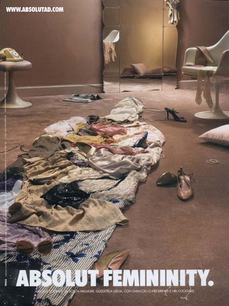 Women's clothing thrown on floor.