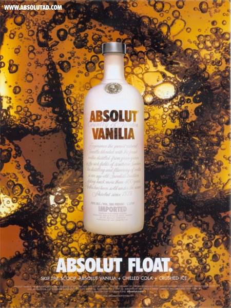 Vanilia bottle floating on cola background.