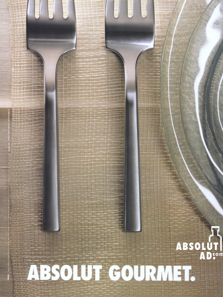 A place setting with bottle shape between 2 forks