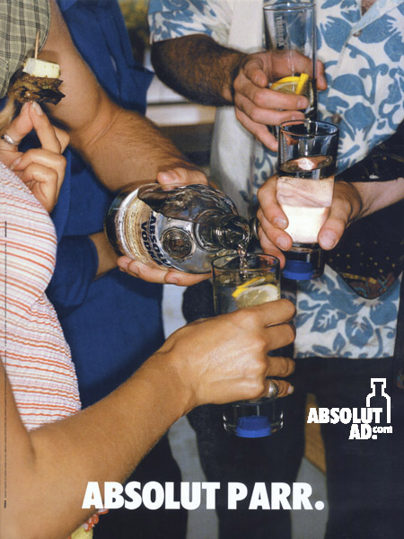 Group of people pouring Absolut at a party.