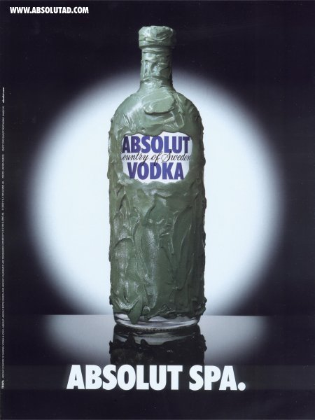 Absolut bottle with spa mud all over.