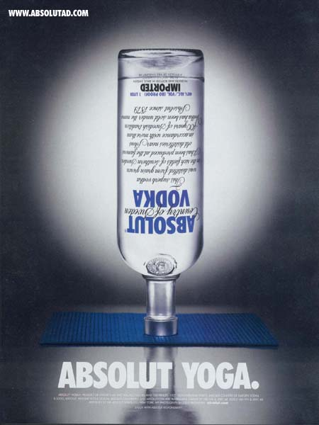 Absolut bottle upsie down on yoga mat.